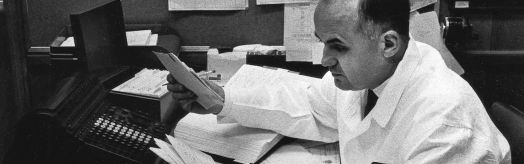 Dr. Hilleman at desk